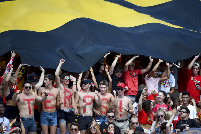 The Maryland Terrapins student section cheers during the first half of an NCAA college football game against the Syracuse Orange, Saturday, Sept. 7, 2019, in College Park, Md. (AP Photo/Will Newton)