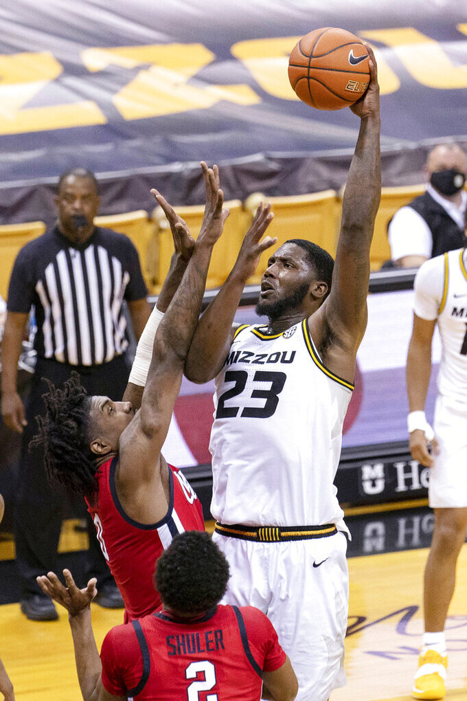 Missouri's Jeremiah Tilmon, right, shoots over Mississippi's Romello White, top left, during the second half of an NCAA college basketball game Tuesday, Feb. 23, 2021, in Columbia, Mo. (AP Photo/L.G. Patterson)