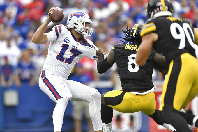 Buffalo Bills quarterback Josh Allen (17) is pressured by Pittsburgh Steelers linebacker Melvin Ingram (8) during the first half of an NFL football game in Orchard Park, N.Y., Sunday, Sept. 12, 2021. (AP Photo/Adrian Kraus)