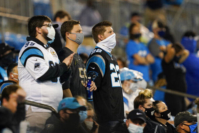 Fans watch during the first half of an NFL football game between the Carolina Panthers and the Atlanta Falcons Thursday, Oct. 29, 2020, in Charlotte, N.C. (AP Photo/Gerry Broome)
