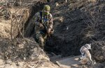 FILE-  In this Nov. 2, 2019, file photo, a Ukrainian serviceman walks up from a trench at the new line of contact in Zolote, Luhansk region, eastern Ukraine. Ukraine is at the center of a major geopolitical battle in the eastern part of the country with Moscow backed separatists. Facing that reality, Zelenskiy is reaching out to Russia directly in a bid to end the conflict before things get worse. (AP Photo/Evgeniy Maloletka, File)