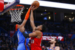 Oklahoma City Thunder forward Darius Bazley (7) blocks a shot by Portland Trail Blazers center Hassan Whiteside (21) in front of Thunder center Steven Adams, right, in the first half of an NBA basketball game Saturday, Jan. 18, 2020, in Oklahoma City. (AP Photo/Sue Ogrocki)