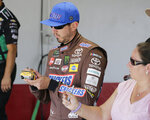 Kyle Busch signs an autograph before practice for a NASCAR auto race on Friday, Aug. 30, 2019, in Darlington, S.C.. (AP Photo/Terry Renna)