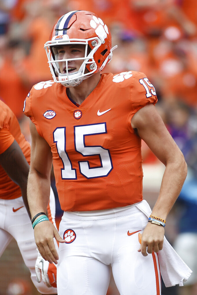 FILE - In this Oct. 7, 2017, file photo, Clemson quarterback Hunter Johnson celebrates after throwing a touchdown against Wake Forest during the second half of an NCAA college football game in Clemson, S.C. Northwestern must replace four-year starter Clayton Thorson, and Clemson backup Johnson is expected to have the inside track. Coach Pat Fitzgerald also is giving fifth-year senior TJ Green a look. (AP Photo/Rainier Ehrhardt, File)