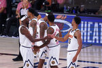 Denver Nuggets players celebrate the team's win over the Los Angeles Clippers in an NBA conference semifinal playoff basketball game Tuesday, Sept. 15, 2020, in Lake Buena Vista, Fla. (AP Photo/Mark J. Terrill)