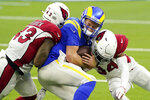Los Angeles Rams quarterback John Wolford center, is tackled by Arizona Cardinals outside linebacker Haason Reddick, left, and free safety Jalen Thompson during the second half of an NFL football game Sunday, Jan. 3, 2021, in Inglewood, Calif. (AP Photo/Ashley Landis)
