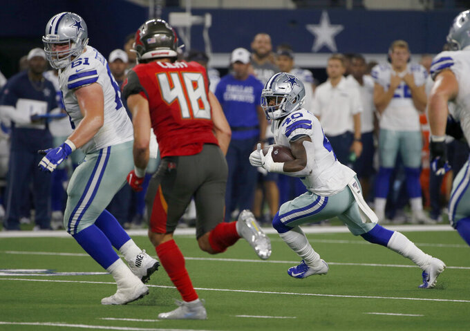 Tampa Bay Buccaneers linebacker Jack Cichy (48) gives chase as Dallas Cowboys center Adam Redmond (61) helps clear a running lane for running back Mike Weber (40) in the first half of a preseason NFL football game in Arlington, Texas, Thursday, Aug. 29, 2019. (AP Photo/Michael Ainsworth)