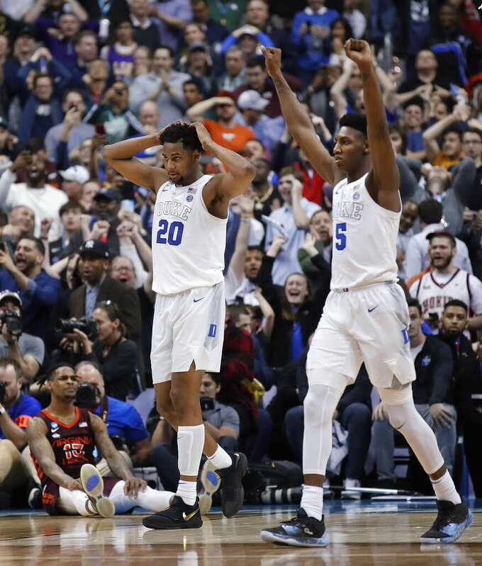 Duke center Marques Bolden (20) and forward RJ Barrett (5) begin to celebrate after Virginia Tech guard Ahmed Hill, lower left, missed a scoring chance in the final seconds during an NCAA men's college basketball tournament East Region semifinal in Washington, Friday, March 29, 2019. Duke won 75-73. (AP Photo/Alex Brandon)