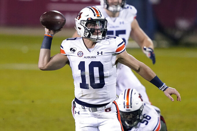Auburn quarterback Bo Nix (10) scrambles while looking for a receiver during the second half of the team's NCAA college football game against Mississippi State, Saturday, Dec. 12, 2020, in Starkville, Miss. (AP Photo/Rogelio V. Solis)