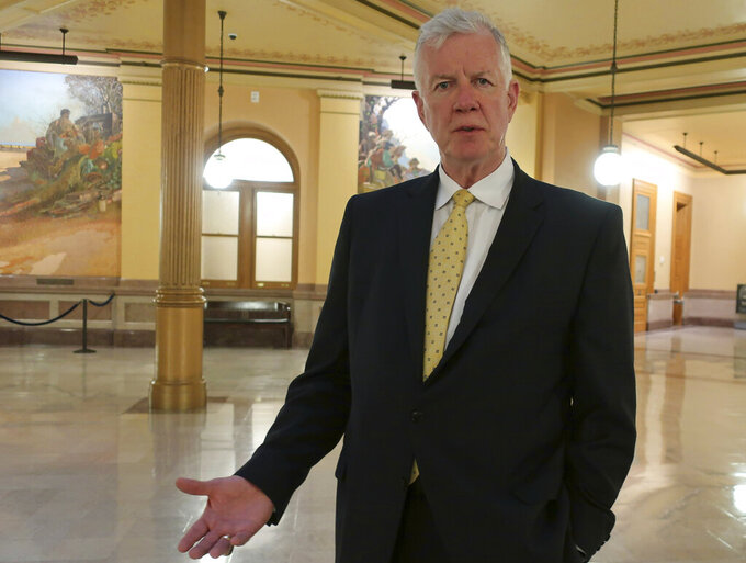 "Dave Lindstrom, a Republican candidate for the U.S. Senate in Kansas, discusses his campaign during an Associated Press interview, Wednesday, June 26, 2019, inside the Kansas Statehouse rotunda in Topeka, Kan. Lindstrom, a former Kansas City Chiefs player, says he is running partly because he's worried about what he sees as a growing embrace of socialism and, ""I think our country's under attack."" (AP Photo/John Hanna)"