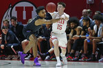 Washington guard Jamal Bey, left, guards Utah guard Rylan Jones, right, in the first half during an NCAA college basketball game Thursday, Jan. 23, 2020, in Salt Lake City. (AP Photo/Rick Bowmer)