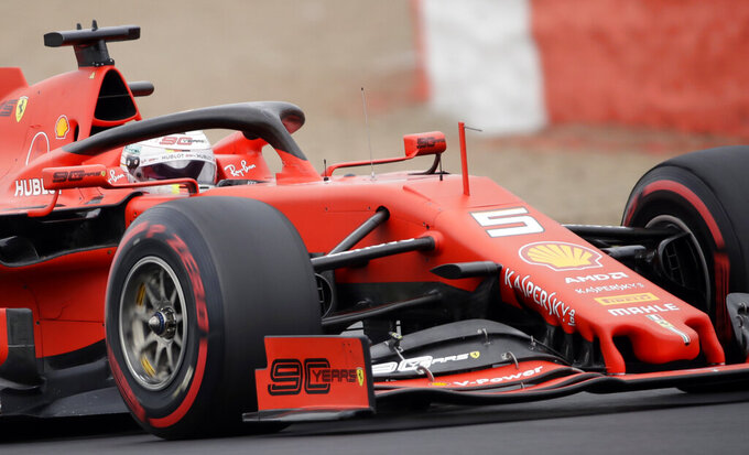FILE - In this file photo dated Saturday, July 13, 2019, Ferrari driver Sebastian Vettel of Germany steers his car during the third free practice at the Silverstone racetrack, in Silverstone, England.  Given Vettel's recent lack of form the last place he might want to race upcoming weekend is his home Grand Prix in Hockenheim, Germany. (AP Photo/Luca Bruno, FILE)