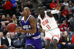 Weber State guard KJ Cunningham, left, drives to the basket as Utah guard Both Gach (11) defends in the first half during an NCAA college basketball game Saturday, Dec. 14, 2019, in Salt Lake City. (AP Photo/Rick Bowmer)