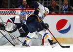 Colorado Avalanche goaltender Semyon Varlamov, back, looks to block a redirected shot off the stick of St. Louis Blues center Ryan O'Reilly in the first period of an NHL hockey game Saturday, Feb. 16, 2019, in Denver. (AP Photo/David Zalubowski)