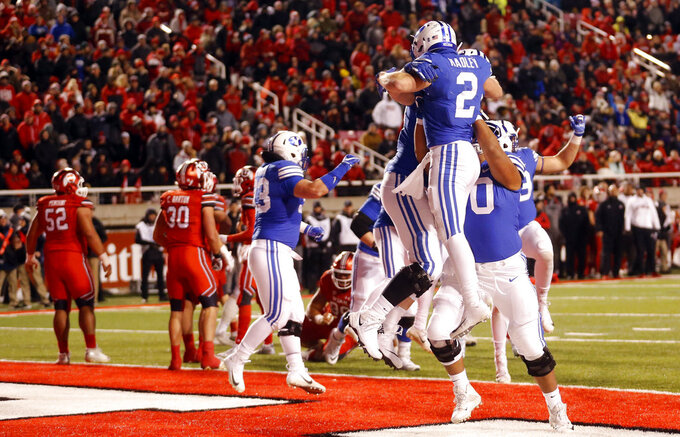 BYU running back Matt Hadley (2) celebrates with teammates after scoring against Utah in the second half during an NCAA college football game Saturday Nov. 24, 2018, in Salt Lake City. (AP Photo/Rick Bowmer)