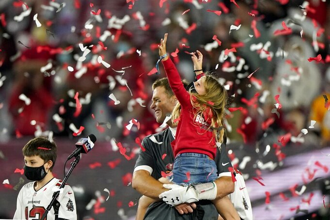Tampa Bay Buccaneers quarterback Tom Brady celebrates with his family after their NFL Super Bowl 55 football game against the Kansas City Chiefs, Sunday, Feb. 7, 2021, in Tampa, Fla. The Buccaneers defeated the Chiefs 31-9 to win the Super Bowl. (AP Photo/Gregory Bull)
