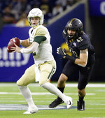 Baylor quarterback Charlie Brewer (12) looks to pass the ball as Vanderbilt linebacker Kenny Hebert (42) closes in during the first half of the Texas Bowl NCAA college football game Thursday, Dec. 27, 2018, in Houston. (AP Photo/Michael Wyke)