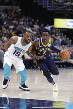 Indiana Pacers' Darren Collison (2) goes to the basket against Charlotte Hornets' Kemba Walker (15) during the second half of an NBA basketball game, Monday, Feb. 11, 2019, in Indianapolis. Indiana won 99-90. (AP Photo/Darron Cummings)