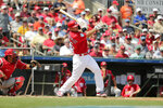 St. Louis Cardinals' Paul Goldschmidt, center, hits a double in the third inning during an exhibition spring training baseball game against the Washington Nationals on Monday, March 11, 2019, in Jupiter, Fla. (AP Photo/Brynn Anderson)