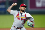 St. Louis Cardinals starting pitcher Carlos Martinez throws during the first inning of the team's baseball game against the Kansas City Royals on Wednesday, Sept. 23, 2020, in Kansas City, Mo. (AP Photo/Charlie Riedel)