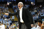 Miami head coach Jim Larranaga directs his players during the first half of an NCAA college basketball game against North Carolina in Chapel Hill, N.C., Saturday, Jan. 25, 2020. (AP Photo/Gerry Broome)