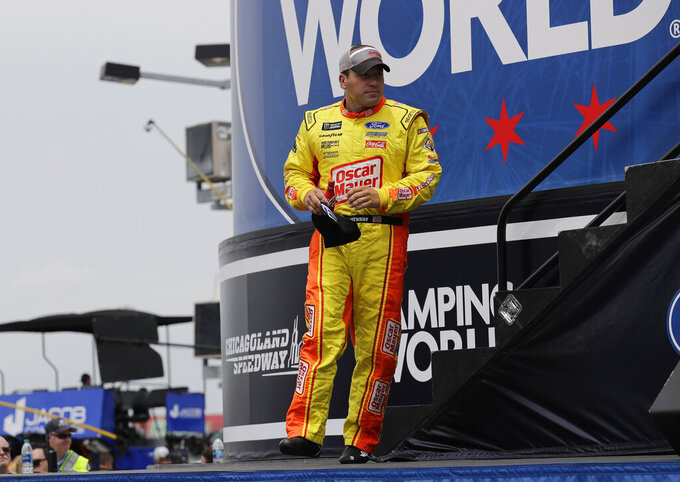 Ryan Newman walks on the stage during drivers introduction before the NASCAR Cup Series auto race at Chicagoland Speedway in Joliet, Ill., Sunday, June 30, 2019. (AP Photo/Nam Y. Huh)