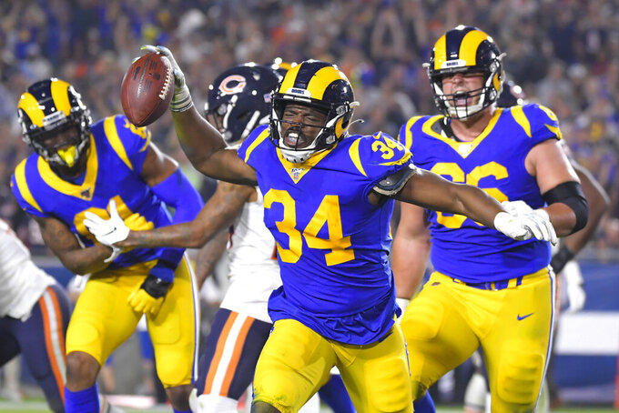 Los Angeles Rams running back Malcolm Brown celebrates after scoring against the Chicago Bears during the second half of an NFL football game Sunday, Nov. 17, 2019, in Los Angeles. (AP Photo/Mark J. Terrill)