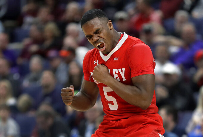Bradley's Darrell Brown celebrates after making a 3-point basket during the second half of an NCAA college basketball game against Loyola of Chicago in the semifinal round of the Missouri Valley Conference tournament, Saturday, March 9, 2019, in St. Louis. Bradley won 53-51. (AP Photo/Jeff Roberson)