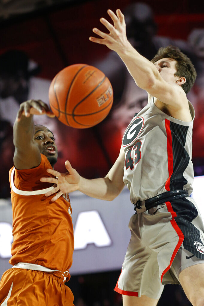 Texas guard Courtney Ramey (3) blocks a shot from Georgia guard Ignas Sargiunas (43) during an NCAA college basketball game in Athens, Ga., Saturday, Jan. 26, 2019. (Joshua L. Jones/Athens Banner-Herald via AP)