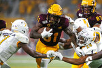 Arizona State running back Isaiah Floyd (31) runs with the ball as Kent State cornerback Jamal Parker (7) and linebacker Mandela Lawrence-Burke (28) attempt to make the tackle during the second half of an NCAA college football game Thursday, Aug. 29, 2019, in Tempe, Ariz. (AP Photo/Ralph Freso)