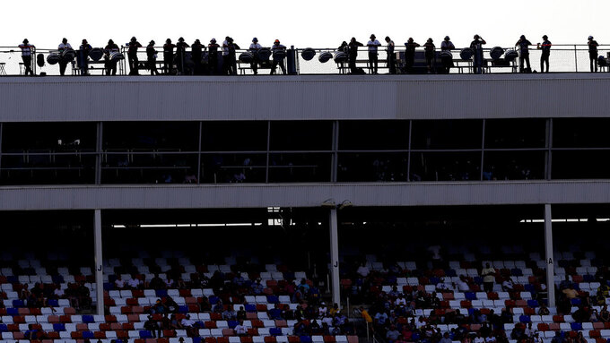Spotters watch from the roof during the NASCAR Cup Series auto race at Charlotte Motor Speedway in Concord, N.C., Sunday, Sept. 29, 2019. (AP Photo/Gerry Broome)