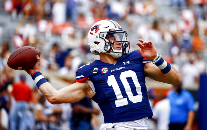 Auburn quarterback Bo Nix warms up before the start of an NCAA college football game against Kentucky on Saturday, Sept. 26, 2020 in Auburn, Alabama. (AP Photo/Butch Dill)
