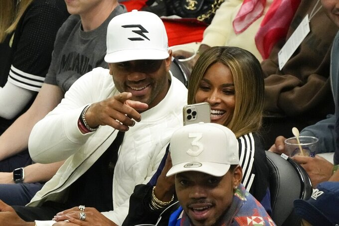 Russell Wilson and wife Ciara are seen during the second half of Game 2 of the NBA Eastern Conference basketball finals game between the Milwaukee Bucks and the Atlanta Hawks Friday, June 25, 2021, in Milwaukee. (AP Photo/Morry Gash)