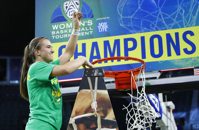 Oregon's Sabrina Ionescu (20) reacts while cutting down the net after defeating Stanford in an NCAA college basketball game in the final of the Pac-12 women's tournament Sunday, March 8, 2020, in Las Vegas. (AP Photo/John Locher)