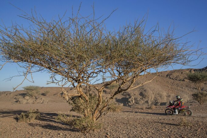 Joan Barreda of Spain rides his Honda motorbike during stage two of the Dakar Rally, between Al Wajh and Neom, Saudi Arabia, Monday, Jan. 6, 2020. (AP Photo/Bernat Armangue)