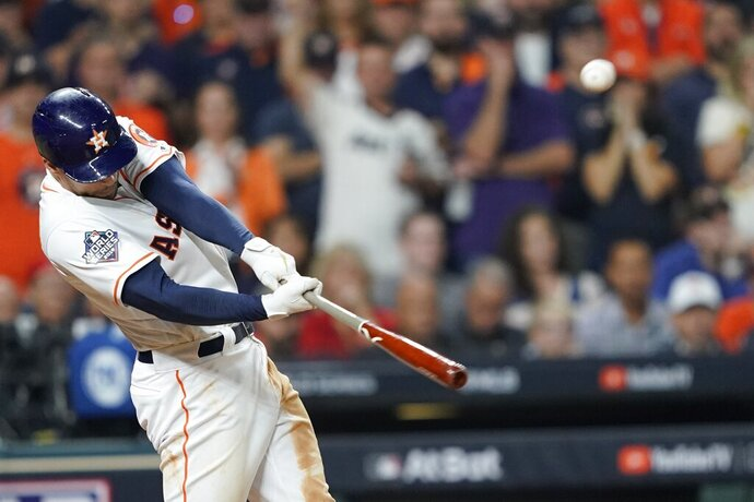 Houston Astros' George Springer hits an RBI double during the eighth inning of Game 1 of the baseball World Series against the Washington Nationals Tuesday, Oct. 22, 2019, in Houston. (AP Photo/David J. Phillip)
