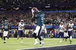 FILE - In this Feb. 4, 2018, file photo, Philadelphia Eagles' Nick Foles catches a touchdown pass during the first half of the NFL Super Bowl 52 football game against the New England Patriots, in Minneapolis. Coaches aren't shy about drawing up trick plays that let quarterbacks use their hands for more than throwing a football. (AP Photo/Jeff Roberson, File)
