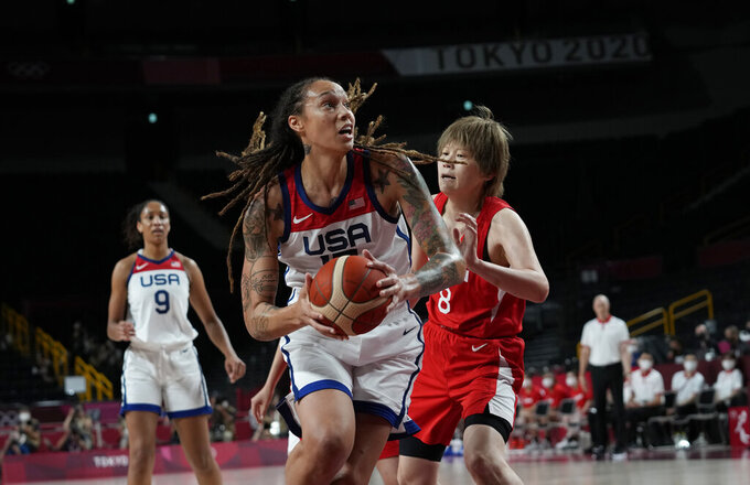 United States' Brittney Griner (15), center, drives Japan's Maki Takada (8) during women's basketball gold medal game at the 2020 Summer Olympics, Sunday, Aug. 8, 2021, in Saitama, Japan. (AP Photo/Eric Gay)