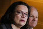 Social Democratic Party, SPD, parliament faction leader and designated party's chairwoman Andrea Nahles, left, and Hamburg's mayor Olaf Scholz, right, attend a news conference at the party's headquarters in Berlin, Tuesday, Feb. 13, 2018. (AP Photo/Markus Schreiber)
