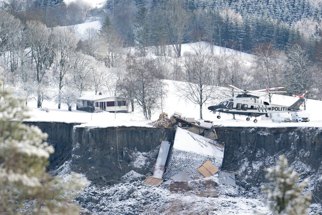 Emergency services near the site of a landslide in Ask, northeast of Oslo, Thursday, Dec. 31, 2020. A landslide smashed into a residential area near the Norwegian capital Wednesday. (Fredrik Hagen/NTB via AP)