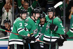 Dallas Stars' John Klingberg (3), Esa Lindell, Andrew Cogliano (11) and Radek Faksa, right, celebrate a goal scored by Lindell in the first period of an NHL hockey game against the Vegas Golden Knights in Dallas, Monday, Nov. 25, 2019. (AP Photo/Tony Gutierrez)