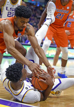 Florida guard Jalen Hudson, left, and LSU forward Kavell Bigby-Williams, right, compete for a loose ball during the first half of an NCAA college basketball game Wednesday, Feb. 20, 2019, in Baton Rouge, La. (AP Photo/Bill Feig)