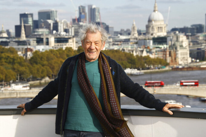 "FILE - In this Oct. 30, 2019, file photo, actor Sir Ian McKellen poses for photographers at a photocall for the film ""The Good Liar""at a central London hotel. McKellen and Andrew Scott were among acting winners as Britain's Laurence Olivier Awards celebrated the best of the London stage in bittersweet fashion Sunday night, Oct. 25, 2020 - most U.K. theaters remain closed because of the coronavirus pandemic.(Photo by Joel C Ryan/Invision/AP, File)"