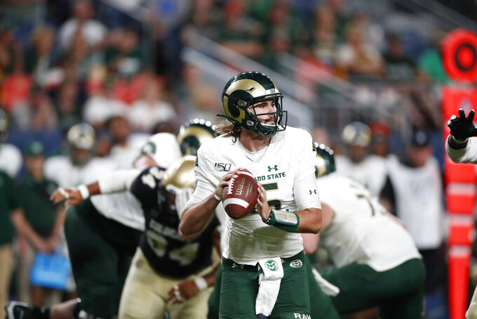 FILE - In this Friday, Aug. 30, 2019, file photo, then-Colorado State quarterback Collin Hill (15) plays in the third quarter of an NCAA college football game against Colorado, in Denver. New South Carolina offensive coordinator Mike Bobo will work with a very familiar face this season, his longtime passer at Colorado State in Collin Hill. Gamecocks coach Will Muschamp said Hill will start when his team opens up on Sept. 26 against No. 15 Tennessee. (AP Photo/David Zalubowski, File)