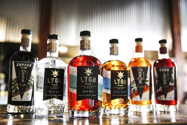 In this Feb. 28, 2020 photo released by Jaime Windon, bottles of alcohol, including Lyon rum, are displayed. Windon Distilling, a Maryland-based producer of Lyon Rum, is among the many craft distillers taking an economic hit from the COVID-19 pandemic. A report released Thursday, Aug. 20 estimates that craft distillers will see an estimated 41% of their sales — worth more than $700 million — evaporate because of the pandemic. (Jaime Windon via AP)