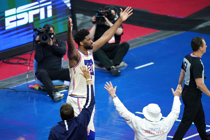 Philadelphia 76ers' Joel Embiid celebrates after an NBA basketball game against the Los Angeles Clippers, Friday, April 16, 2021, in Philadelphia. (AP Photo/Matt Slocum)