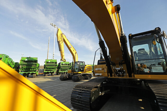 FILE - In this Nov. 4, 2019, file photo construction equipment made by Caterpillar are readied for export to Asia at the Port of Tacoma in Tacoma, Wash. Caterpillar Inc. reports financial results Friday, Jan. 31, 2020. (AP Photo/Ted S. Warren, File)