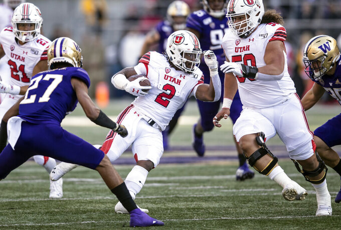 Utah running back Zack Moss (2) runs with the ball during the first half of an NCAA college football game against Washington, Saturday, Nov. 2, 2019, in Seattle. (AP Photo/Stephen Brashear)