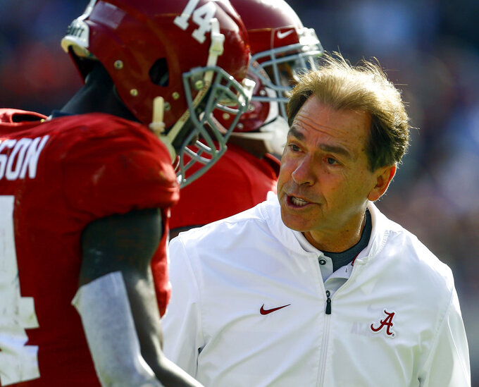 Alabama head coach Nick Saban talks with Alabama defensive back Deionte Thompson (14) after a play during the first half of an NCAA college football game, Saturday, Nov. 17, 2018, in Tuscaloosa, Ala. (AP Photo/Butch Dill)