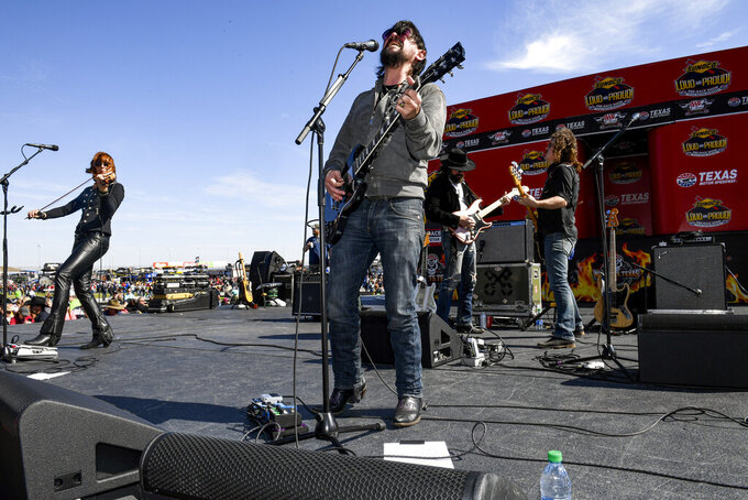 Shooter Jennings performs before a NASCAR auto race at Texas Motor Speedway, Sunday, Nov. 3, 2019, in Fort Worth, Texas. (AP Photo/Larry Papke)